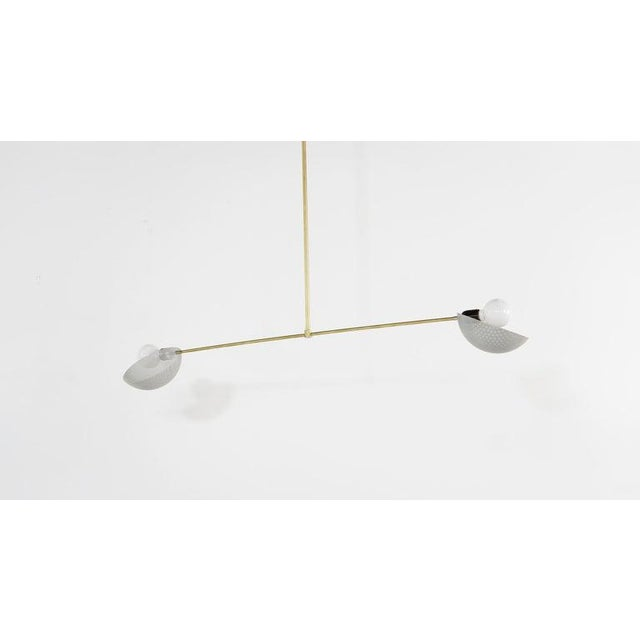 The Axial pendant is a ceiling fixture with a strong modern design defined by balance and equilibrium. Axial features two...