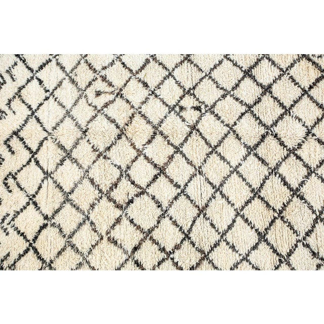 Moroccan Berber rug from the Beni Ouarain tribes. Lush white and black organic wool rug with geometrical lozenges designs....