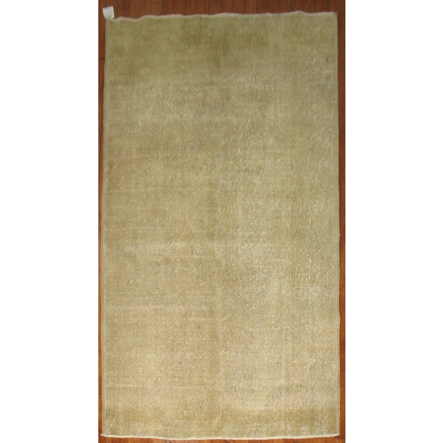 Offered is a vintage Turkish rug in a brown / taupe color. This rug's neutral color will blend into a variety of styles....