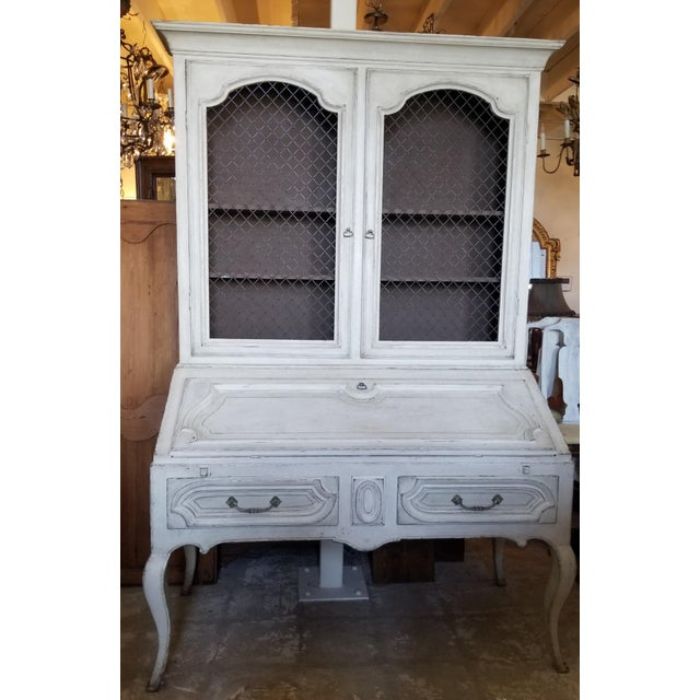 Vintage hand painted French style secretary with bookcase top and drop front desk with two drawers below.
