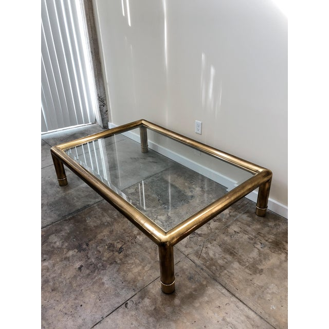 Large tubular brass coffee table with glass top. Shows beautiful patina and solid construction. Overall great condition,...