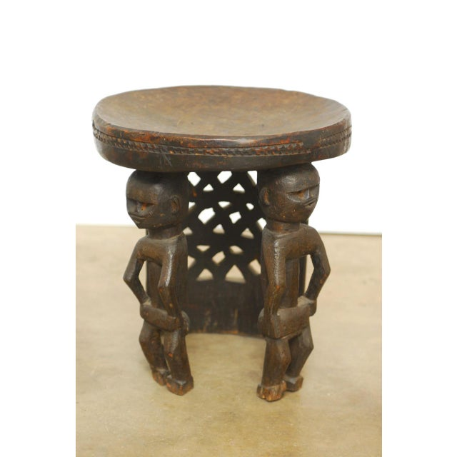 African Carved Tribal Stool with Figural Legs For Sale - Image 12 of 12