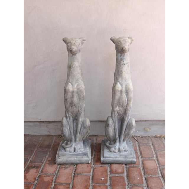 These Classic dog sculptures were crafted in France, circa 2010. The stately, vintage greyhounds are set on a flat base...