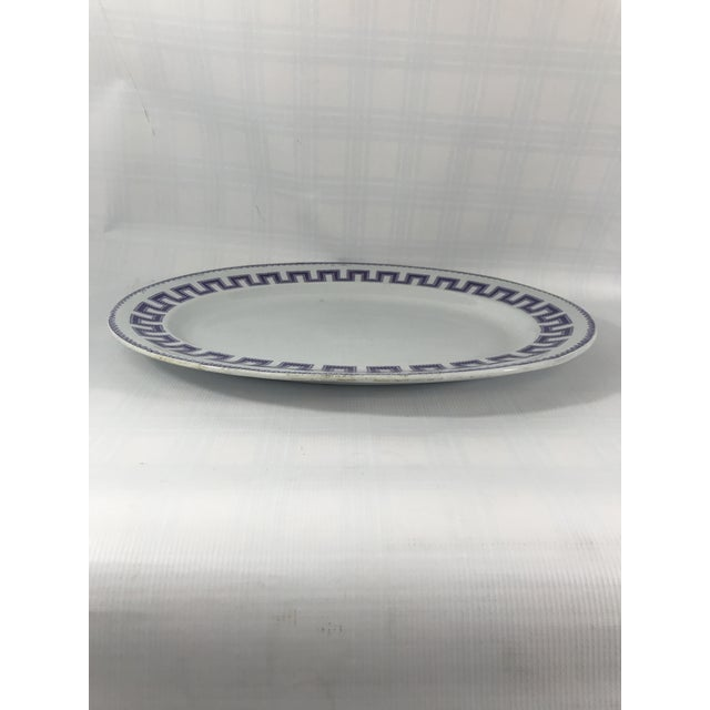 Large oval ironstone platter with purple Greek key transfer decoration.