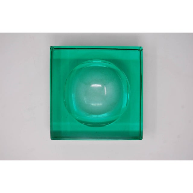 "Large, green glass dish with concave center, attributed to Fontana Arte, circa late 1930s-early 1940s. Measures: 6 3/4"" x..."
