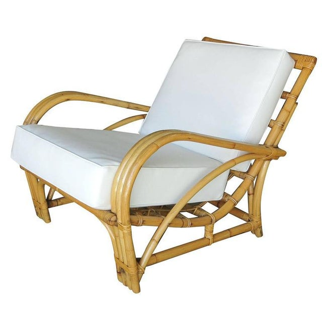 """Three-strand """"1940s Transition"""" rattan lounge chair. This chair dates from 1940. The arm style flows sinuously into a the..."""