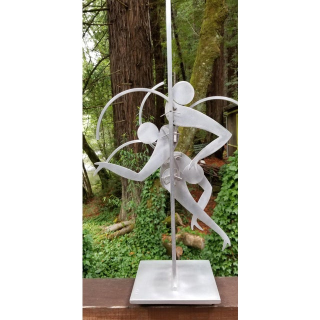 Exceptional abstract kinetic metal table top sculpture by Jerome Kirk. Dancing figures, signed and dated 1995. Sculpture...