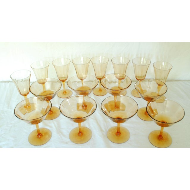Delicate crystal amber glass set of sixteen wine glasses. The bowls are slightly ridged. The size stated is for the taller...
