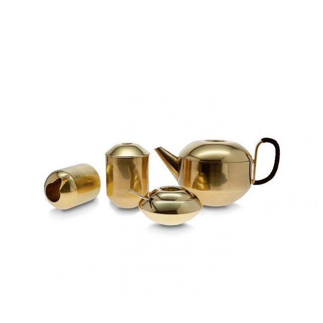 An archetypical British mascot; a round teapot made from spun brass, polished and then dipped in a warm gold wash to give...