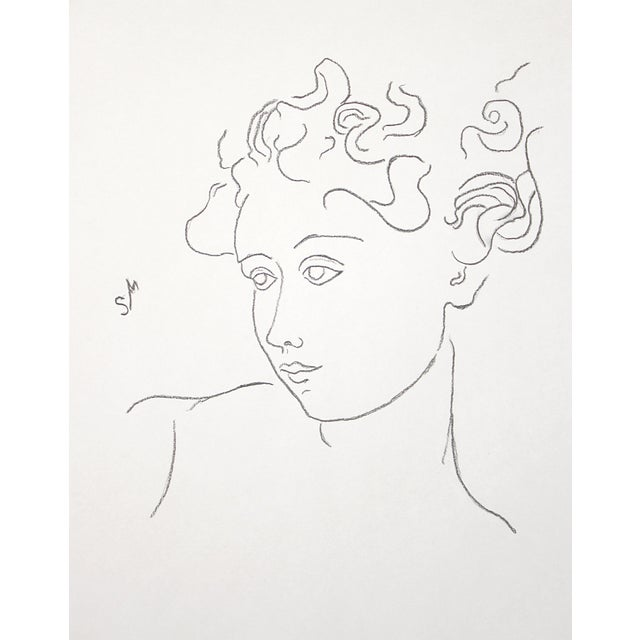 Simple lines create the face of a young woman with an expressive glance, raised brows – she might be about to smile. Her...