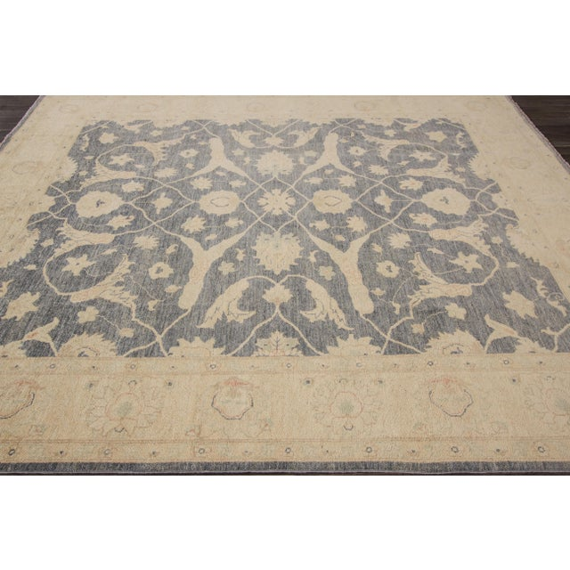 This beautiful hand-knotted Peshawar rug has a great design with magnificent detailing. This piece will make your floor...