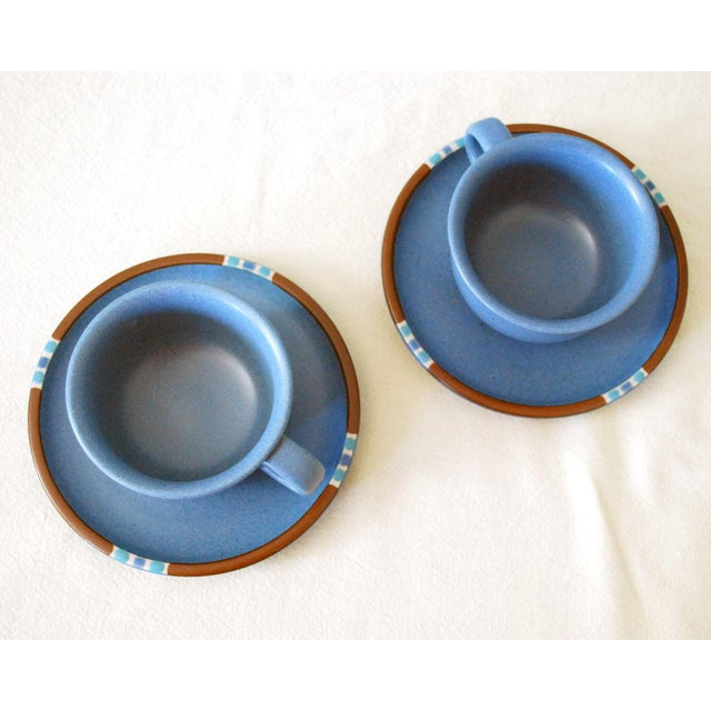 Two sets of vintage Dansk Mesa Sky Blue flat cups and saucers, dating to the 1980s and made in Japan. This is a popular...