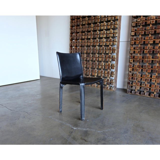 """Black leather """"CAB"""" side chair by Mario Bellini for Cassina."""