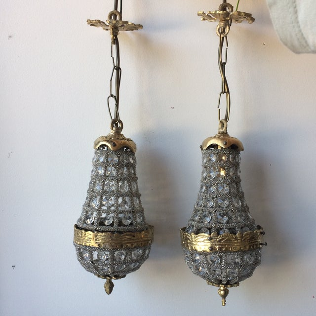 Pair of petite mini empire chandeliers with acanthus details which would accent any space beautifully. Hang together or...