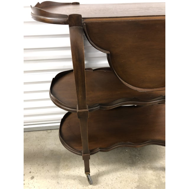 Elegant bar cart or console on brass casters. Two fold out leaves that can be locked up with a sliding mechanism. Leaves...