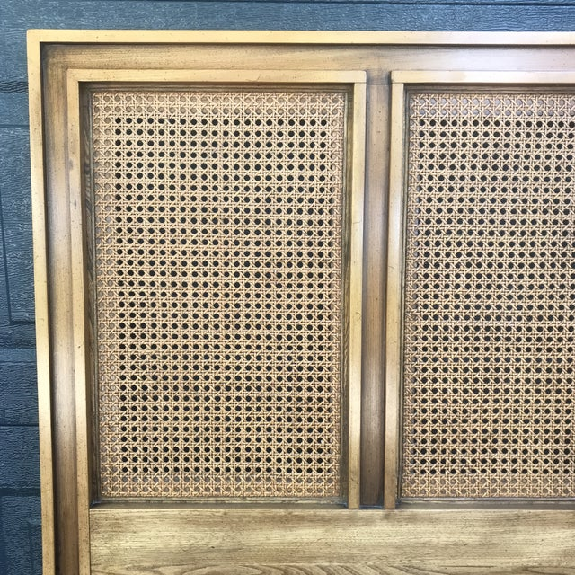 Mid century design with Four panels of caning across the top. Made by West Michigan furniture company