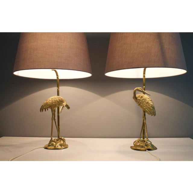 Nice set of of two Crane brass table lamps. The shade is new. Good original condition. Possible to wire the lamps for the US.