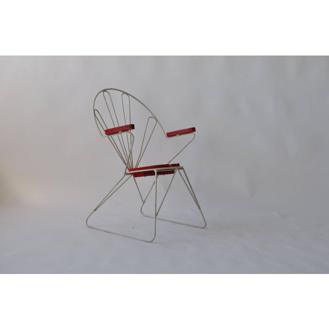 Pair of Swedish Garden chairs. Painted iron with painted seats and armrests.