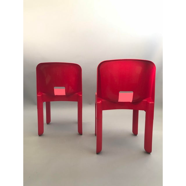 Pair of Red Universale Joe Colombo Chairs for Italian Manufacturer Kartell. The first all-plastic chair made by the...