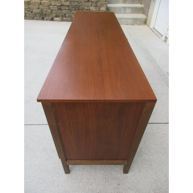 Mid Century Walnut Triple Dresser with Reversible Cane Side Panels For Sale - Image 10 of 11
