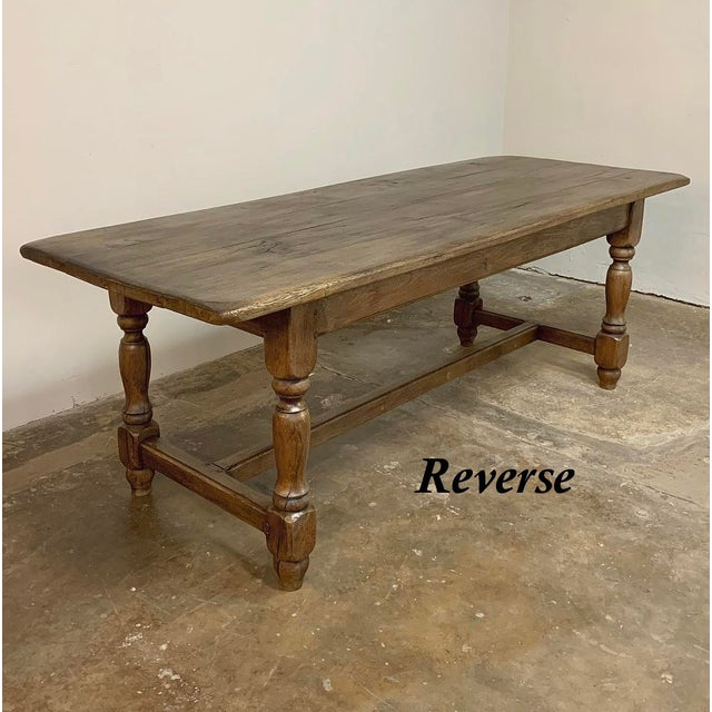 19th Century Country French Farm Table features generous overhangs on the ends, which is a rarity. Four turned posts...
