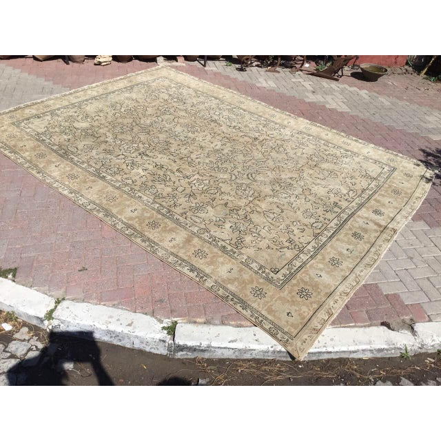 Gorgeous hand knotted area rug made in early 1900s by Anatolian tribes. This collectible rug is made with all hand spun...