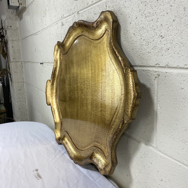 This is a great and functional large gold leaf wood tray. Not particularly old, but vintage. It's size and thickness and...