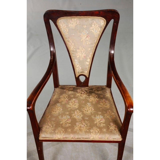 Pair of Art & Crafts armchairs made in England, around 1900, solid beechwood, stained on mahogany, elegantly curved frame,...