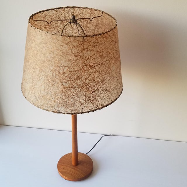A great simplistic Mid-Century Modern Swedish Table Lamp with a beautifully textured lampshade. The design and the 'Made...