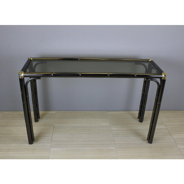 "Vintage faux bamboo metal console in a pewter finish with brassplated fitting and smoke glass top Dimensions: 47""Width x..."