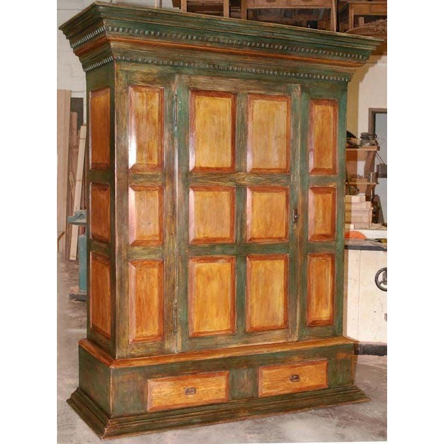This massive armoire was handmade in our Latvian workshop entirely from antique elements and using traditional joinery...