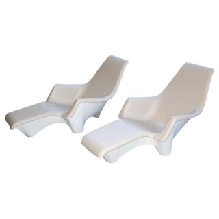 A Sculpted Pair of American 1960's Fiberglass Lounge Chairs