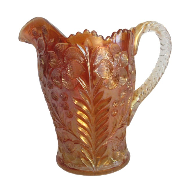 An antique Imperial marigold carnival glass water pitcher made by the Imperial Glass Co. in Imperial's famous embossed...