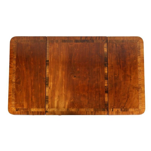 With rectangular inlaid top with central sliding reversible gameboard, with gameboard removed exposing a backgammon...