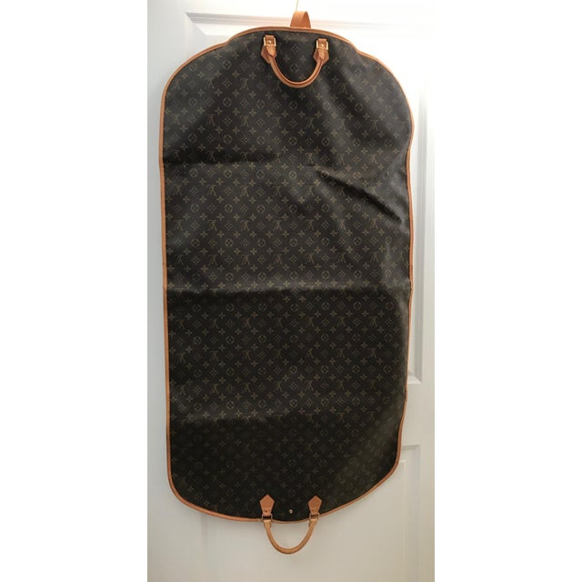 Louis Vuitton Vintage Weekend/Travel Bag Color: Monogram Canvas Brown Material: Leather Style: Garment Cover BA4120...