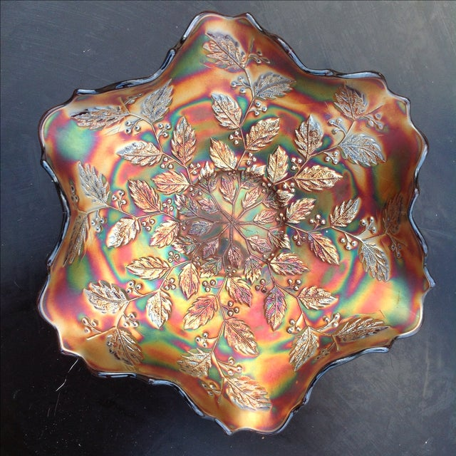 Amethyst Carnival Glass Holly Bowl. This bowl was produced by Fenton glass over a hundred years ago. The colors, which are...