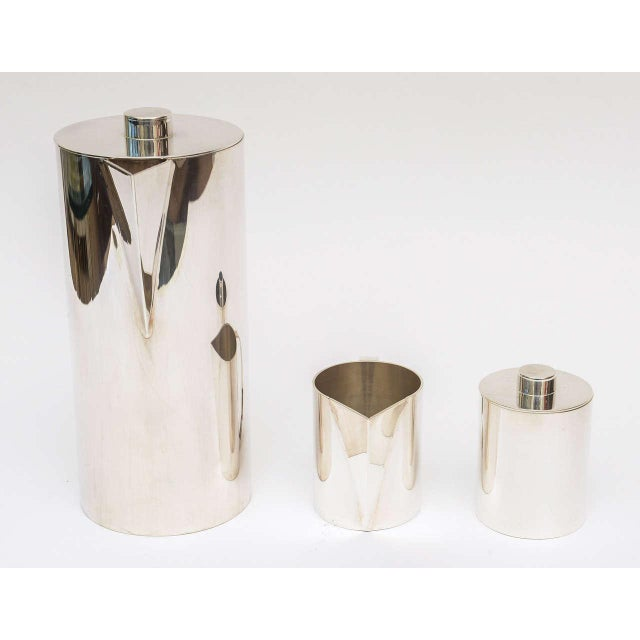 This modernist silver plate coffee service is timeless. It has been all polished. Signed on the bottom.