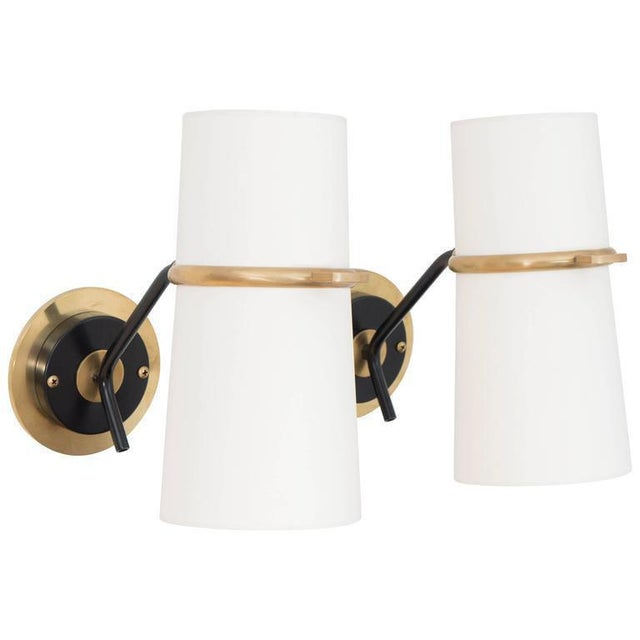 Pair of sconces from french designer boris lacroix. Articulated double shades with double sockets for maximum illumination.