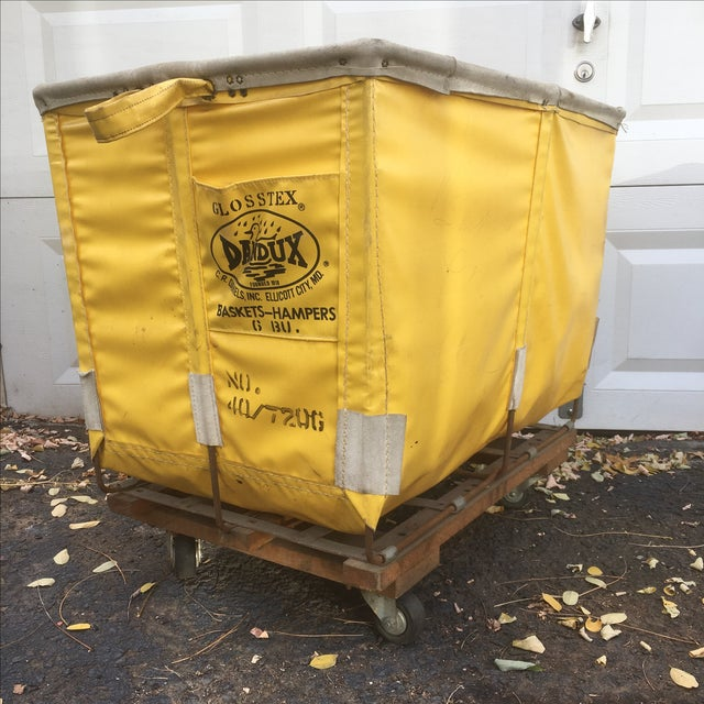 Vintage Dandux laundry cart is a bold shade of yellow set on strong vinyl. Unlike many, this one is completely free of...