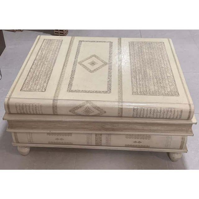 Neoclassical white- parchment leather book coffee table by Maitland-Smith, Three beautiful stacked warm white to parchment...