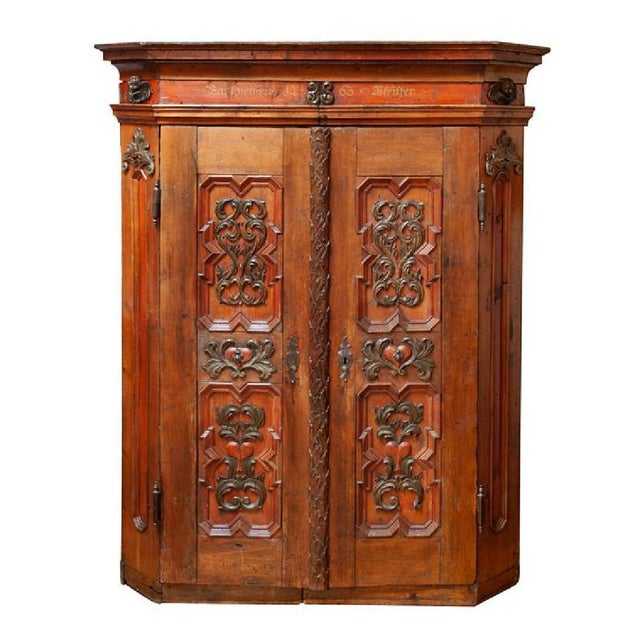 Austrian carved and painted wood large double door cupboard, dated 1763. The structure of wood features a shaped top...