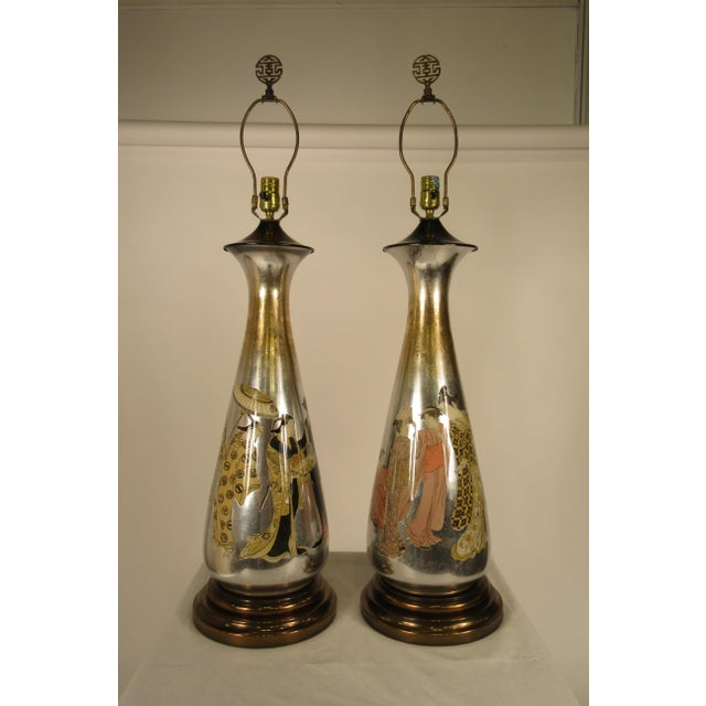 Pair of 1950s tall églomisé silver leaf Asian lamps out of a Scarsdale, NY estate. Lamps have original wiring, needs...