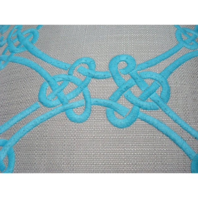 A welted down/feather pillow with great color and texture. We love the bright turquoise Celtic-knot embroidery against the...