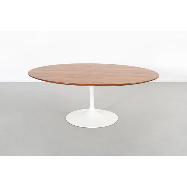 """coffee table designed by Eero Saarinen for Knoll USA, c 2007 - 50th anniversary edition rosewood + cast aluminum 15 ⅜"""" h x..."""