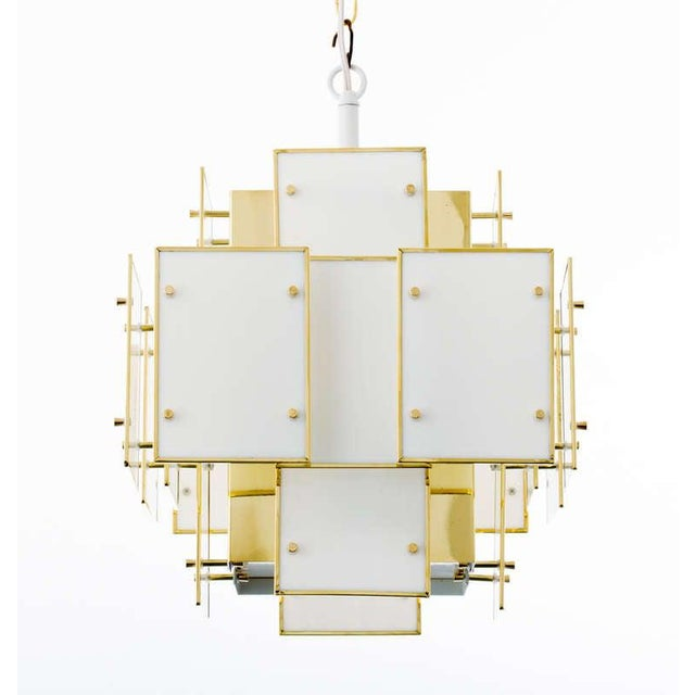 Milk glass panel chandelier with brass fittings, in the style of Robert Sonneman. One socket with 150w. maximum wattage....