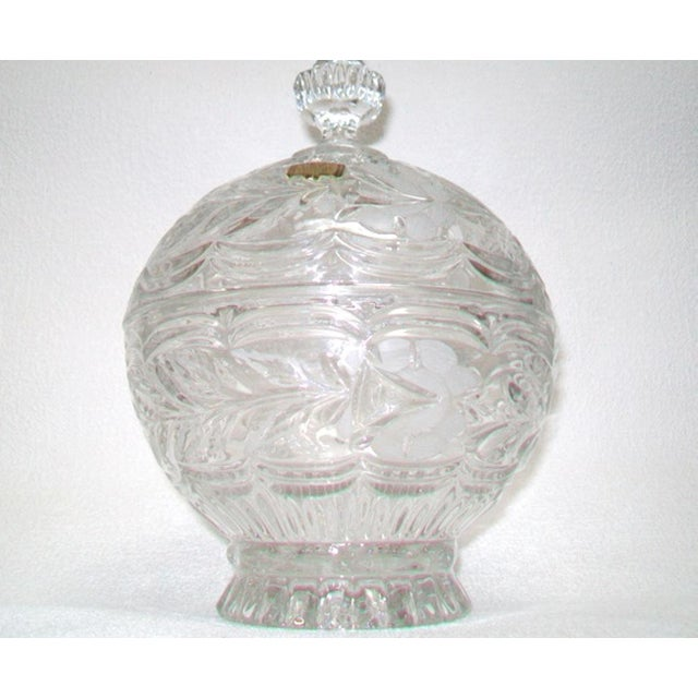 A stunning European crystal domed lidded dish with a cut and frosted design throughout and a spire knot on the domed lid....