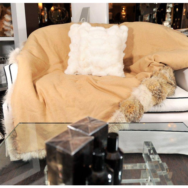White pieced fox fur pillow with white leather back.
