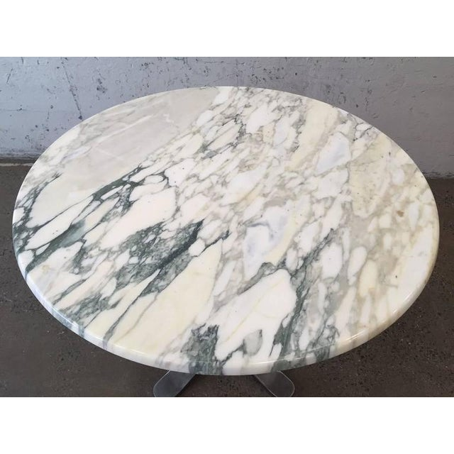 Nicos Zographos marble-top table with chrome steel base.