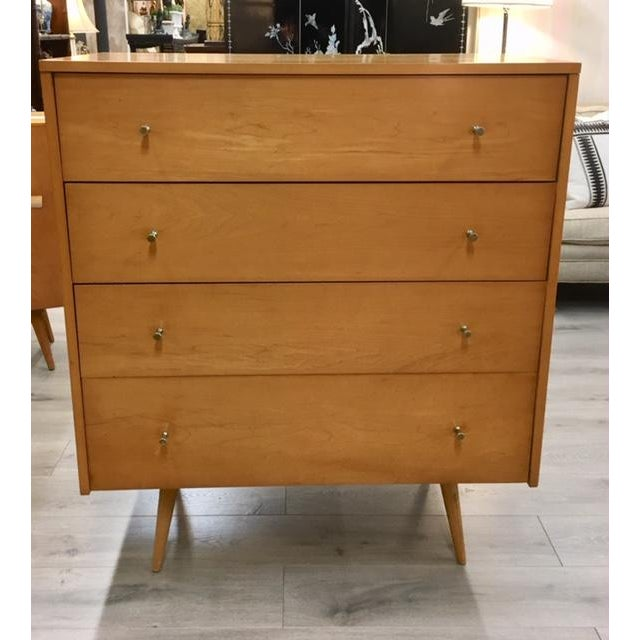 Tall maple 4 drawer peg leg dresser Paul McCobb Planner Group produced by Winchendon in the 1950s.