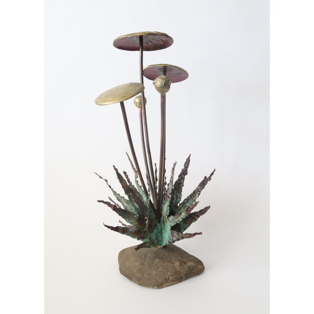A beautiful and unique vintage metal sculpture depicting mushrooms and dandelion leaves on a stone base. Metal has a rich...